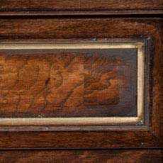 Hyde Park / Gold Metallic Leaf (LG590): Rich warm dark walnut-colored stain, lightly distressed, burnished edges; some pieces include ash burl drawer fronts with a lighter finish.