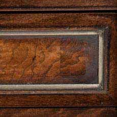 Hyde Park / Silver Metallic Leaf (LS590): Rich warm dark walnut-colored stain, lightly distressed, burnished edges; some pieces include ash burl drawer fronts with a lighter finish.