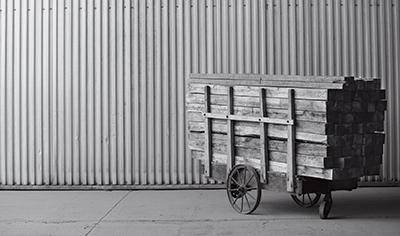 cart of raw lumber